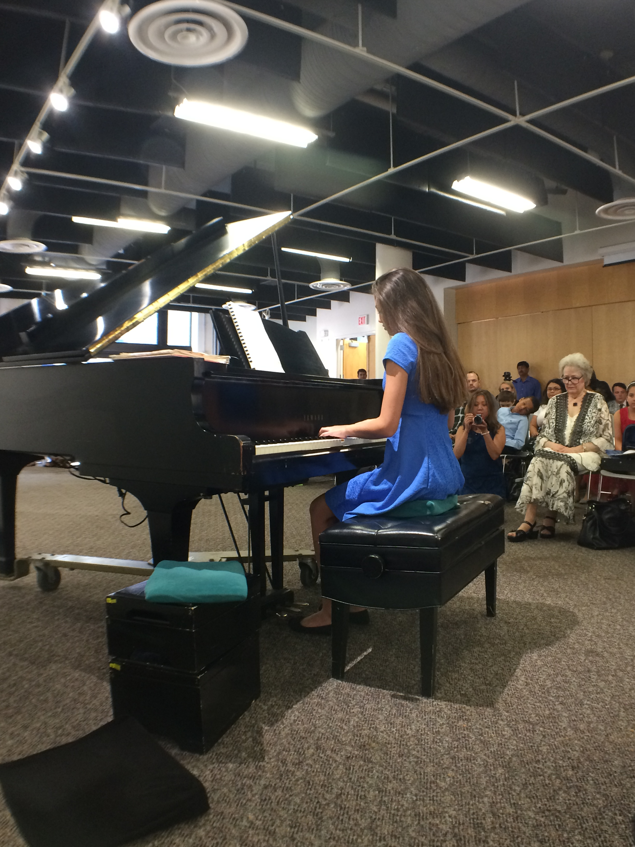 A female student playing the piano solo
