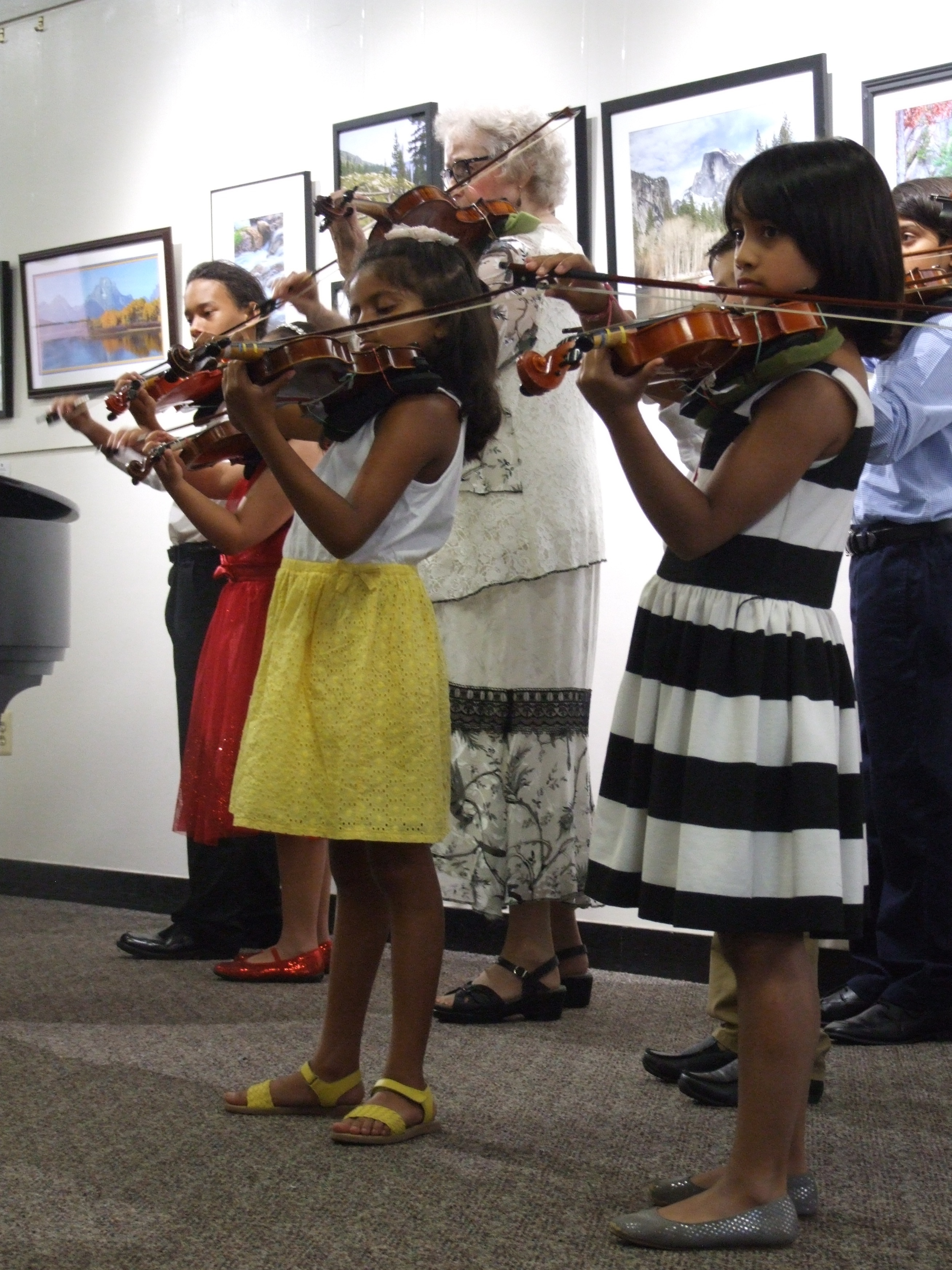 Students playing their violins