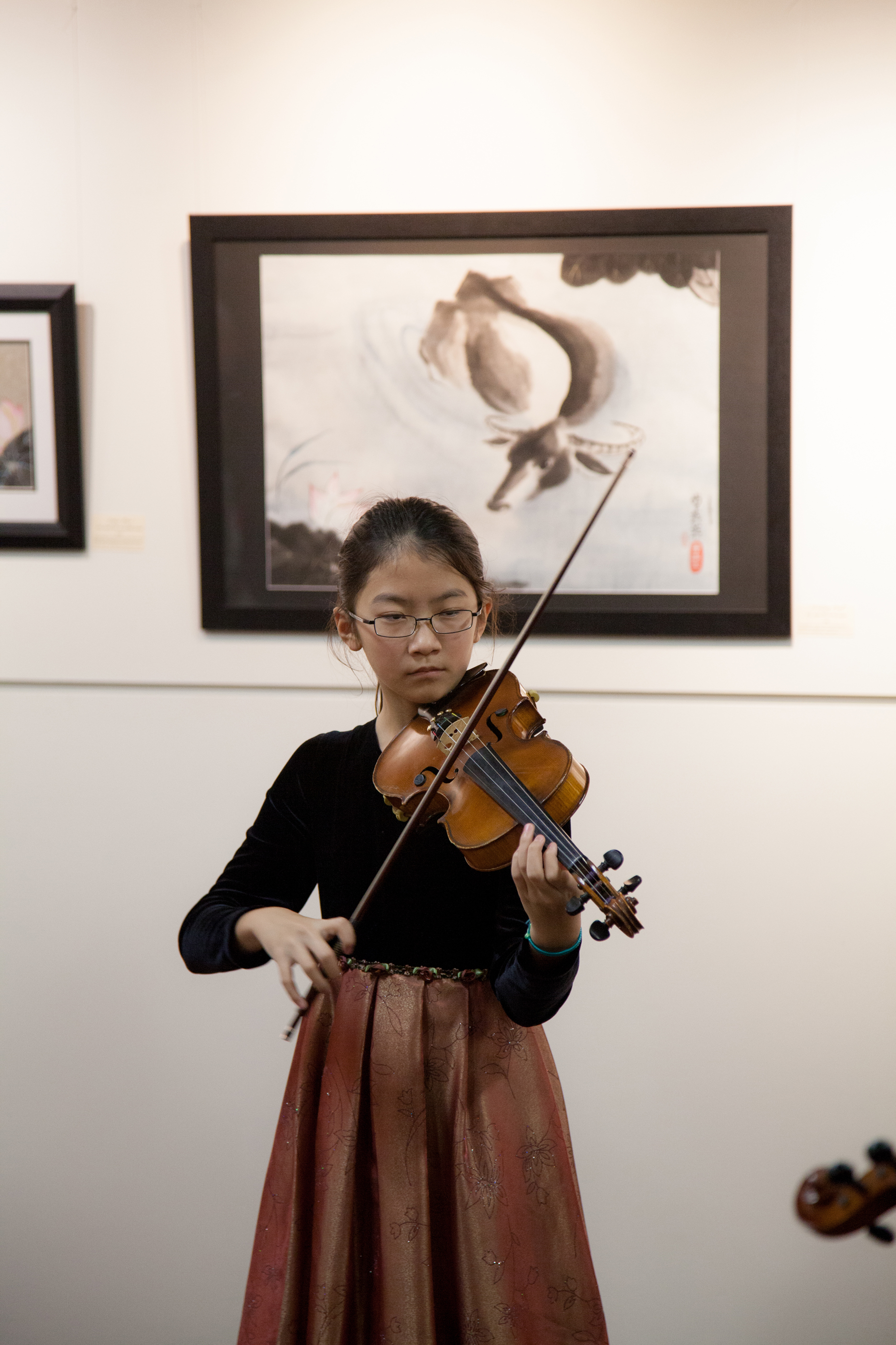 A female playing the violin