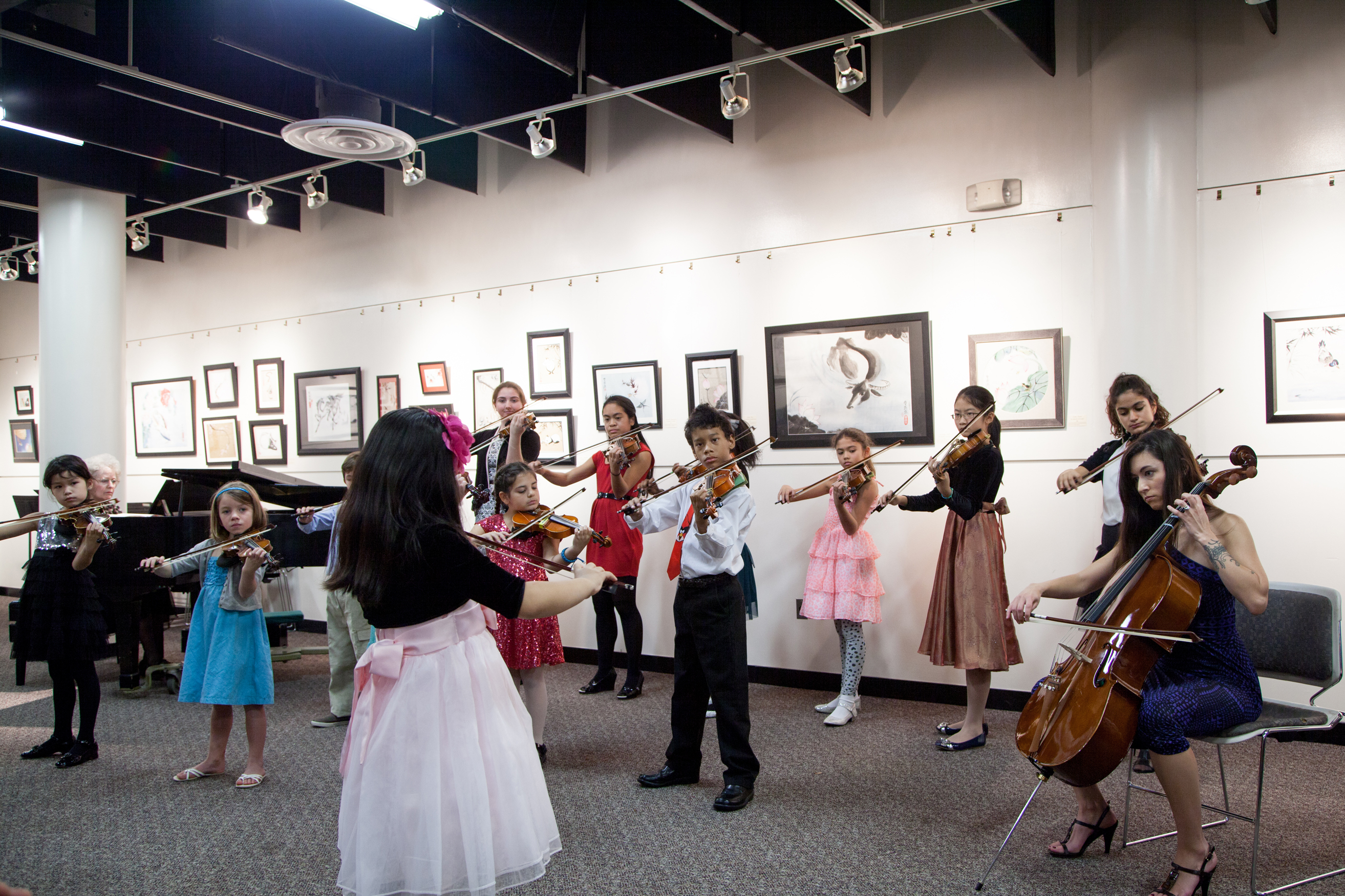 Students playing their violins together
