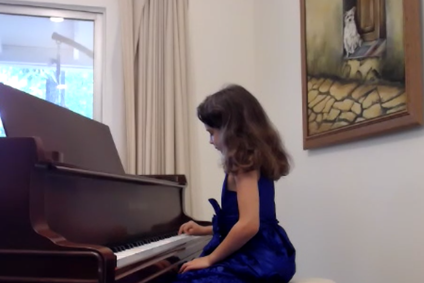 Young Girl in Blue Dress Playing Piano