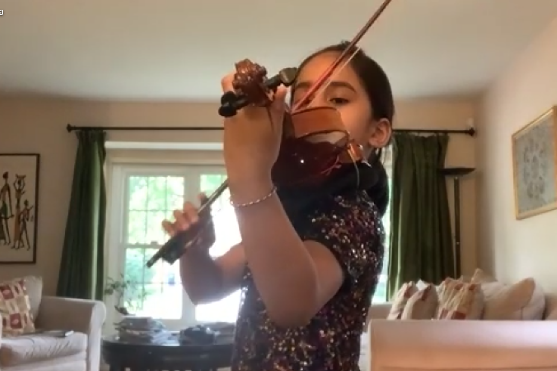 Up Close of Young Girl Playing Violin